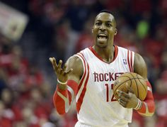 Houston Rockets' Dwight Howard (12) reacts during the first half in Game 2 of an opening-round NBA basketball playoff series against the Portland Trail Blazers Wednesday, April 23, 2014, in Houston. (AP Photo/David J. Phillip)
