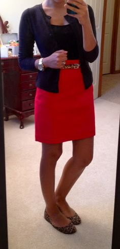 Red skirt, black tank & sweater...Love it, minus the flats tho....