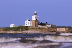 Coquet Island lighthouse through the waves, Amble, Northumbria, England