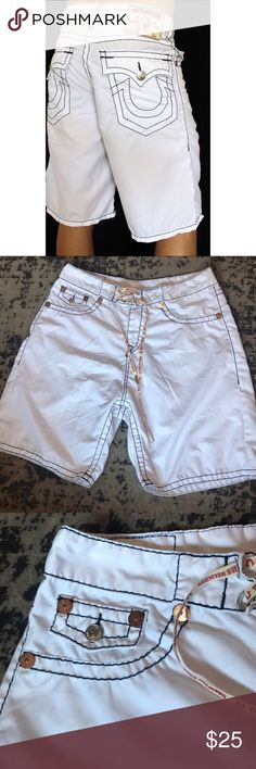 "Surf Shorts Very good condition. There are two tiny pulls by the back pocket as shown in pictures. Inseam- 8 1/2"". Rise- 12"". Waist across front- 17"". True Religion Shorts"