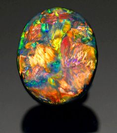 Very Fine Black Opal from Lightning Ridge, Australia. I think opal is my favorite stone Minerals And Gemstones, Rocks And Minerals, Beautiful Rocks, Mineral Stone, Rocks And Gems, Stones And Crystals, Gem Stones, Bunt, Lightning Ridge