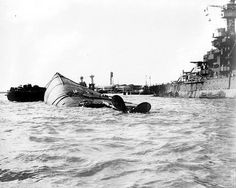 US battleship after Japanese attack on Pearl Harbor.USS Oklahoma overturned, after being hit by 9 Japanese torpedoes