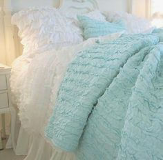 like the fluffy aqua throw with the white bedding could be different colors maybe silver and white for the Paris Room.