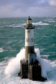 Lighthouses of Iroise - Phare d'Ar-Men sur le rocher du même nom, au large de l'île de Sein. Finistère.  Brittany