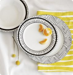 Love all the fun prints that are available with hand painted dinnerware? Achieve a similar look by simply drawing patterns onto some plain  white dishes from Goodwill with a Sharpie :D or paint pen!