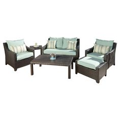 Woven outdoor seating group set with fade-resistant cushions and aluminum framing. Includes 1 loveseat, 2 arm chairs, 1 side table, 1 ottoman, and 1 coffee t...