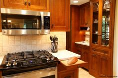 Gorgeous Wood Work (After). A look at the appliances installed.