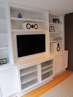 Wall Unit with flat screen TV. Designed and built by New York Design and Construction