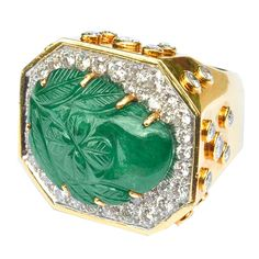 """DAVID WEBB .18 kt. gold and diamond ring, centering a large carved emerald in a """"paisley"""" motif. Approx. diamond weight - 4.50 carats. Signed. USA circa 1980s"""
