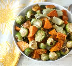 Roasted Sweet Potatoes and Brussels Sprouts #SundaySupper - A simple, flavor, vegetarian side dish made with roasted sweet potatoes, Brussels sprouts and onion and seasoned with herbs.