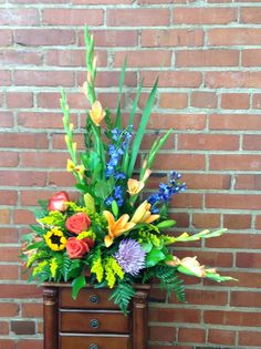 Glads,delphinium, sunflowers,lilies,and roses for a grandpa funeral spray.