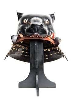 Unusual samurai war helmet with black-lacquered bear's head, late 16th century, Japan