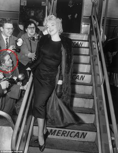 Hull (circled) , who worked for Pan Am, became close to the star while part of a group of fans known as the Monroe Six who followed the star from place to place, here the star boarding a plane for Hollywood at Idlewild Airport in New York on February 25, 1956. One of the images in this set way signed by Marilyn: 'To Frieda Love & Kisses'