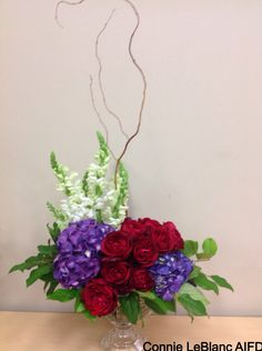 Garden Roses, Hydrangeas,Snapdragons,Salal & Curly Willow designed in a Crystal Vase