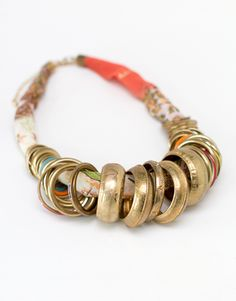 chunky ethnic style necklace, reminiscent of a broken column
