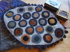 Old velvet and wool penny mat made by Maggie Bonanomi. Winding Vine Wanderings