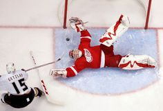 Dominik Hasek makes a floppy, diving save that only Hasek can make on Ryan Getzlaf during the first period of Game 2 of the 2007 Western Conference final. (Getty Images) Another patented snow angel save by the dominator. Hockey Goalie, Hockey Mom, Hockey Teams, Hockey Players, Ice Hockey, Hockey Stuff, Detroit Hockey, Detroit Sports, Detroit Michigan