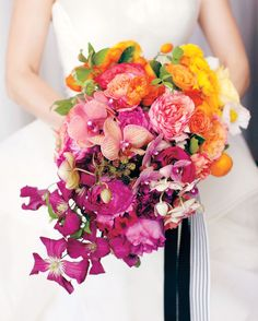 Hanna's bouquet by Sinclair and Moore incorporated a floral-fruity mix of garden roses, tea roses, poppies, kumquats, tangerines, Meyer lemons, ranunculus, phalaenopsis orchids, peonies, blackberries, clematis, and sweet peas.