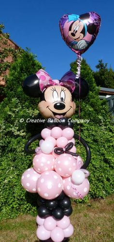 Minnie Mouse sculpture with balloons