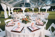 30x50 clear top tent with a combination of cafe lights in a zig zag formation and white lanterns hung randomly throughout.