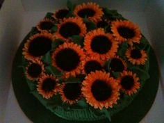 A field of sunflowers - Friend of mine wanted a birthday cake that looked like a field of sunflowers with absolutely everything to be edible!!