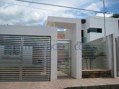 fachadas de casas modernas con rejas -