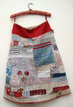 Old quilt turned skirt, I am seriously blissed out by this woman's textile collage creations!