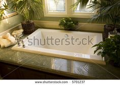 Upscale bathroom with a modern tub and tile floor - stock photo