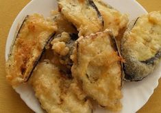 Quick frying in hot oil keeps eggplant from getting oil-soaked. Enjoy melitzanes tiganites as a side dish or, with other dishes, as a meze. Greek Recipes, New Recipes, Cooking Recipes, Favorite Recipes, Recipies, Yummy Vegetable Recipes, Side Dish Recipes, Side Dishes, Greek Dishes