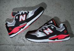 """New Balance drops another neon '90s-inspired look for the 530, with this colorway in black, hot red and grey. Calling to mind an iconic 90s color scheme, the """"Hot Lava"""" Nike Air Tech Challenge, the mix of hues is right … Continue reading →"""