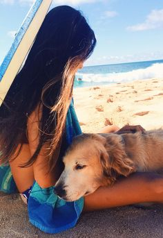 the golden life, this could totally be me and candy. Me taking a break from surfing and petting my golden