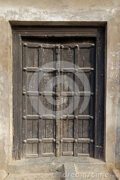 This Image Is Of An Very Traditional Hindu Temple Door Made Of Wood With  Iron Stud