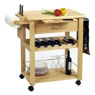 Kitchen Cart, Deluxe By Winsome Wood by Winsome Wood. $186.13. 6 bottle wine rack. a knife block. a lower shelf. a smooth surface perfect for cutting meat or vegetables. This rolling kitchen cart features a knife block, a 6 bottle wine rack, a lower shelf, and a smooth surface perfect for cutting meat or vegetables. Sturdy, simple, and convenient. Made of Solid beechwood. Assembly Required