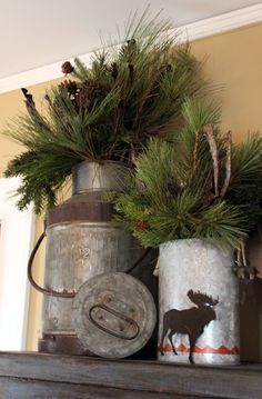 Great way to use those tin cans and place pine tree branches with pine cones for holiday decor