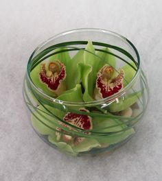small bubble bowl with cymbidium orchids and lily grass