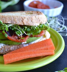 The Totally Awesome Sandwich - this completely veggie sandwich could not be more delicious or satisfying…filled with tomatoes, avocado, sprouts and a zesty topping! | @tasteLUVnourish