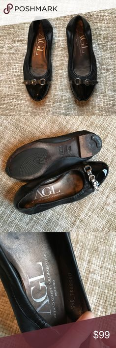 """AGL Black Cap Toe Ballet Flats Step out in sweet simplicity with this ballet flat from Attilio Giusti Leombruni. This chic leather flat has classic silhouette and a patent leather toecap for a touch of detail. The leather and rubber soles are flexible and soft for a smooth, comfortable stride. This is a timeless addition to your shoe closet. Style: D558034 Condition: upper leather looks perfect, soles show wear and have protective taps, insoles have discoloration Approx. ¼"""" stacked heel Made…"""