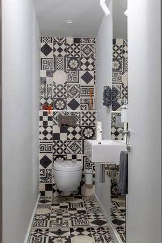 The small powder room features graphic ceramic tile from Couleurs & Matures Patc. - The small powder room features graphic ceramic tile from Couleurs & Matures Patchwork. A Parisian Pied-À-Terre by Piret Johanson Studio Small Bathroom Wallpaper, Bathroom Design Small, Bathroom Interior Design, Bad Inspiration, Bathroom Inspiration, Bathroom Ideas, Wc Bathroom, Bathroom Flooring, Bathroom Furniture