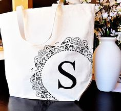 Cute personalized tote. Only thing I would change is use my Silhouette to make the stencils rather than the doily and cutting a letter out.