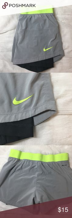 Nike running shorts with built in spandex These gym shorts do have a small tear in the seam by he hip that can easily be fixed with a little stitch. However, they do still for great and have many runs left in them! Nike Shorts