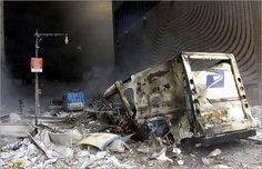 September 11, 2001 | A US postal service truck amid rubble near the base of the destroyed World Trade Center.