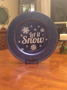 For me: Gold and each plate have lyrics from Christmas songs.  Vinyl Decorated Charger Plate by PersonalizedBliss on Etsy, $10.00