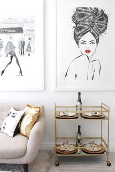 Beautiful illustrations surrounded by gold accent decor in Australian fashion artist Megan Hess' home office.