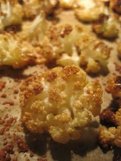 Cauliflower Popcorn: serves 4 (or, if I'm around, 1) 1 head cauliflower 3T extra virgin olive, grapeseed or coconut oil (warmed to liquid state) 1/2-1t salt, or to taste 3T grated parmesan (optional) Preheat oven to 425 degrees. Trim the cauliflower head; reserve the core and stems for another use. Cut florets into the size of ping pong balls (they will shrink a bit as they roast).