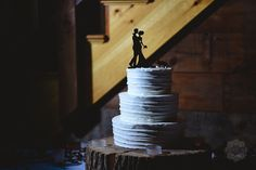 Wedding cake with cat friend silhouette cake topper. Photo by Arius Photography, ariusphoto.com