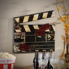 Give your media room a retro feel with Kirklands Antiqued Movie Clap Plaque. With a distressed finish and red movie tickets this piece celebrates the history of film. It would look great on the walls of your family room! Theater Room Decor, Movie Theater Rooms, Home Theater Setup, Home Theater Speakers, Home Theater Seating, Home Theater Design, Movie Rooms, Cinema Room, Bedroom Decor