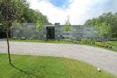 Solid natural stone front and entrance by Archplan