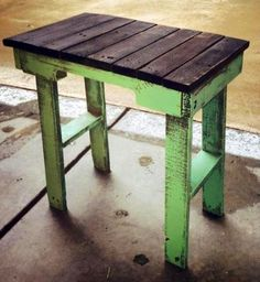 Side table made from pallet wood pieces. Painted green and lightly distressed, top stained
