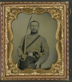 Confederate Cavalryman with Virginia state seal belt plate, revolver and cavalry sword. Confederate Cavalryman with Virginia state seal belt plate, revolver and cavalry sword.