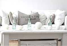 white decor, I love white with burlap and beige and rope and natural looking glass ... very beachy ... sea shells strewn about ....